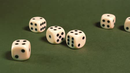 riskantní : Game dice thrown on green table