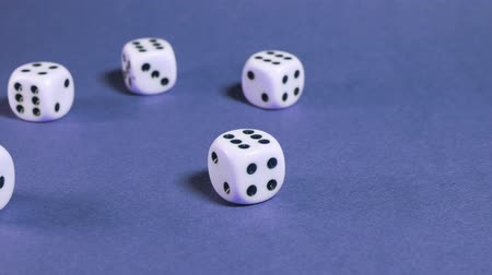 Ко : White dice thrown on blue table