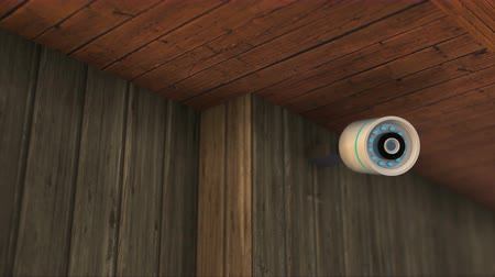 Modern security camera on wooden roof soffit. 4K UHD infinite loop 3D video animation.