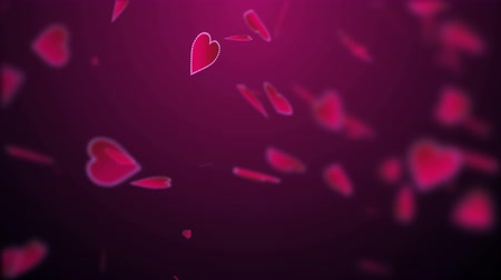 Slow Falling Red Heart Blurred Background. 4K UHD animation intro.