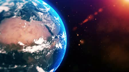 Sunrise over planet Earth. Realistic globe with star dust in 4K 3D animation.
