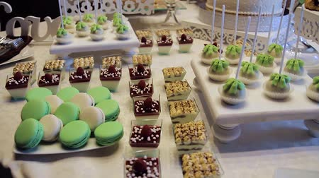 şekerleme : Tasty wedding reception candy bar dessert table inside celebration hall