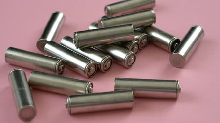 alkaline : Used alkaline electric batteries and size AAA isolated on a pink background
