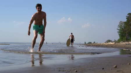 sicília : Water sport skimboarding on the wild beach