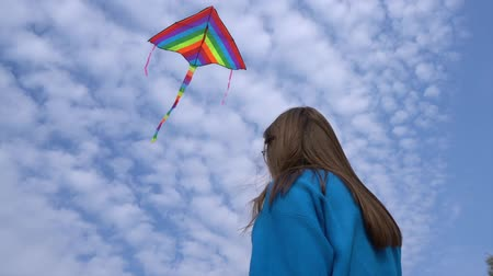 Girl with kite flying