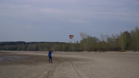 Girl with kite flying in the sky