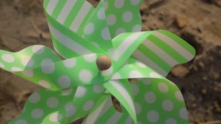 Pinwheel rotates close-up on sand background