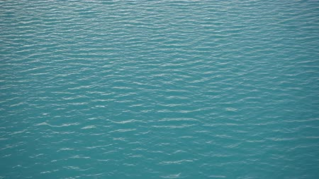 Bright blue water surface close up
