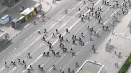 Many cyclists ride along the road. Stock Footage