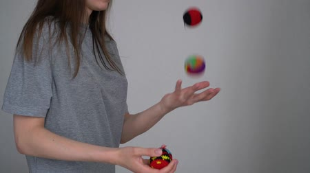 Girl juggles close up in slow motion.