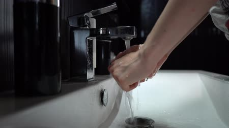 The girl washes her hands close-up. Stock Footage