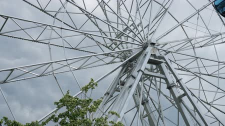 Metal construction of the Ferris wheel rotates close-up.