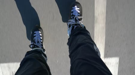 inline skating : Close-up roller skates of a riding roller, first-person view. Stock Footage