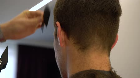 shaves : Hairdresser cuts a man close-up.
