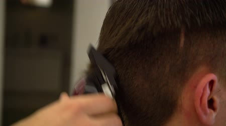 shaves : Barber makes a haircut with a hair clipper. Stock Footage
