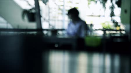 food court : Blurred defocused of people in vintage restaurant cafe silhouette in blue  cold morning tone full HD