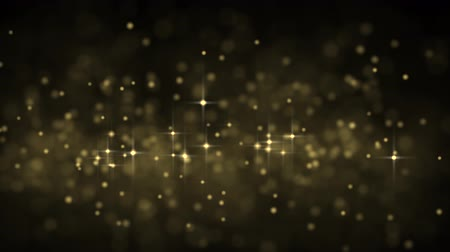 orange background : Golden glowing star particle in random direction  3D render abstract background  animation motion graphic with copy space on black background
