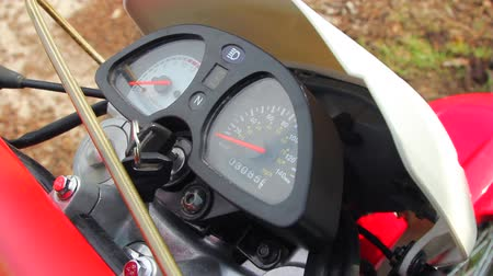 autobike : Closeup shot of a motorcycle dashobard. Tachometer pointer is moving when biker depresses accelerator.