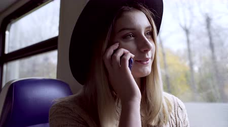 Teen girl talking to her mum during train trip
