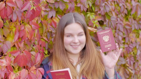 Beautiful woman with two russian passports