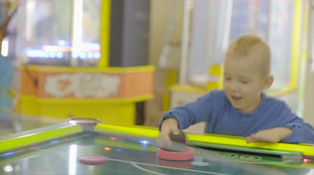 Little boy plaiying air hockey