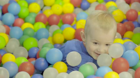 Little boy in ball pool