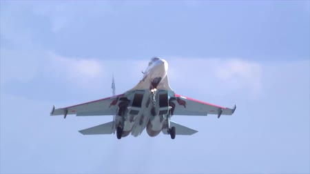 silahlar : A military fighter jet SU-27 taking off from the airfield during military exercises