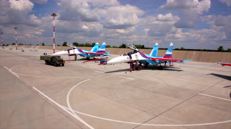 might : Three russian military fighters SU-27 standing at landing field after trainings