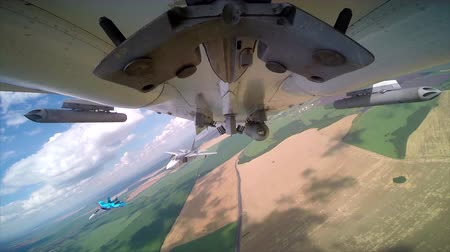 might : Bottom of the bombers fuselage SU-24 with armed bomb and two convoy fighters during russian air force readiness check