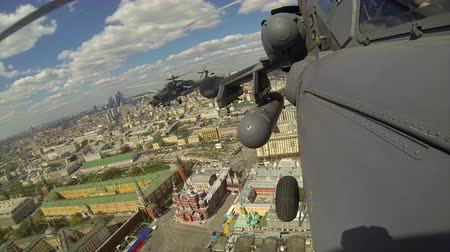 mi : 2017, the 7th of May, Russia, Moscow: - Military helicopters MI-28 flying over the city of Moscow over the Red Square during the rehearsal of the Victory Day parade on the 9th of May Stock Footage