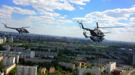 might : 2017, the 20th of March, Russia, Moscow: - Military helicopters MI-28 flying over the city in the blue sky