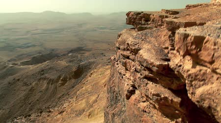 licht : up and over cliff face of mitzpe ramon crater