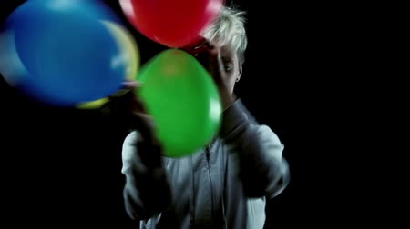 Woman dancing fast with balloons