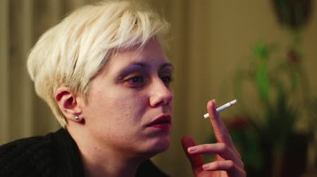 Young, Blond Haired Woman Working Late At Night And Smoking A Cigarette Stock Footage