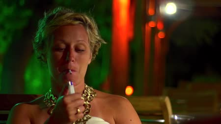 Woman Smoking In Restaurant Stock Footage