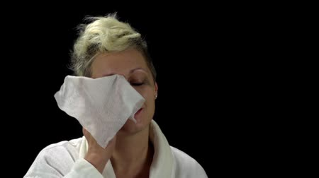 Young Woman Removing Make-Up From Her Face