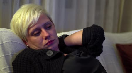 Young, Blond Haired Woman Resting Stock Footage