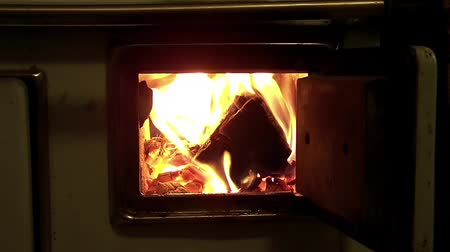 open hearth : Slow Motion Fire In Furnace With Opened Doors Stock Footage