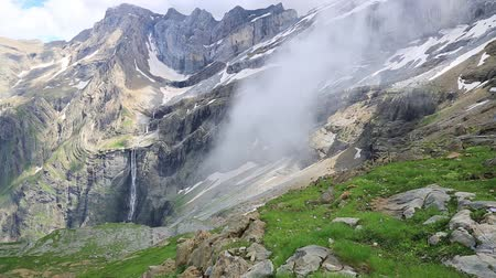 snowfield : The Cirque of Gavarnie with famous waterfall, Pyrenees, France.