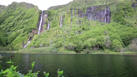 göl : Waterfalls on Flores island and lake with lake in foreground Azores archipelago Portugal Stok Video