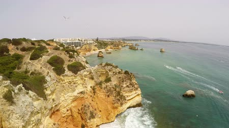 portugalsko : Aerial from natural rocks near Lagos in the Algarve Portugal Dostupné videozáznamy