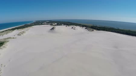 говорю : Aerial footage of the Slowinski National Park in Poland - mowing dunes
