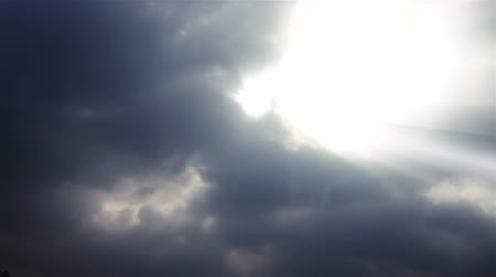 bouře : time lapse of the clouds billowing and moving with god rays.