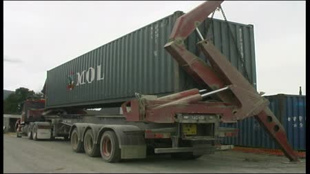 Truck loads a 40 foot shipping container at a West Coast factory, New Zealand