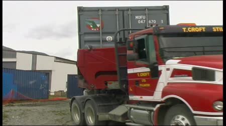 Truck carries away a 40 foot shipping container from a West Coast factory, New Zealand
