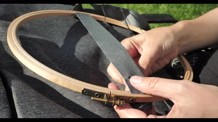 шитье дамского платья : sewing hands of girl sunlighted making a new product zooming frame