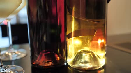 розы : Two glasses of champagne and different colors bottles of wine exhibition in the wine bar space in Spain