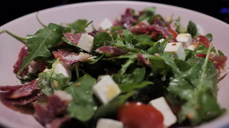 smoked : A plate with the spanish cheff salad with goat cheese, jamon and green rucola