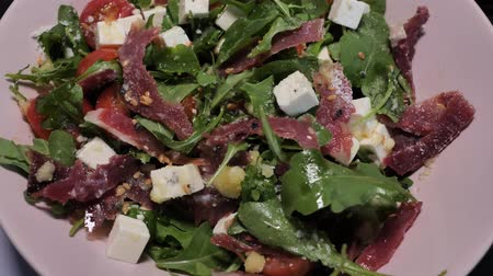 eflatun : A plate with the spanish cheff salad with goat cheese, jamon and green rucola