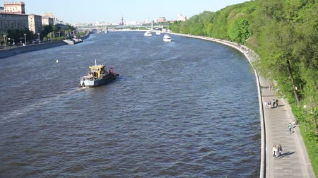 Moscow river view, people walking along embankment